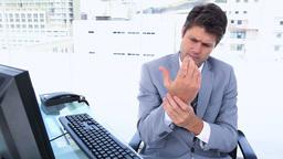 Businessman with sore wrists Footage