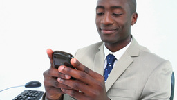 Black businessman texting on a smartphone Stock Video Footage