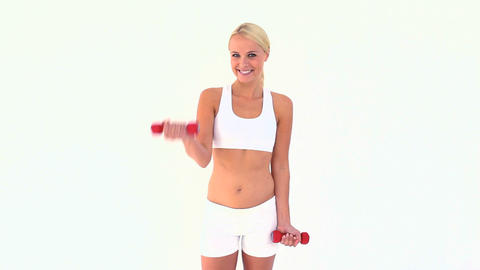 Blonde using dumbbells Stock Video Footage