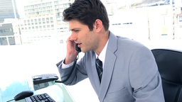 Businessman picking up a landline Footage