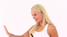 Smiling blonde lifting her nails Footage