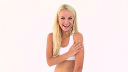 Blonde applying moisturizer on her arm Footage