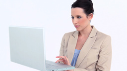 Young businesswoman using a laptop Footage