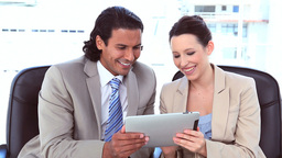 Happy business people using a digital computer Footage