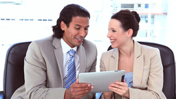 Happy business people using a digital computer Stock Video Footage
