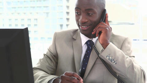 Black businessman working while phoning Footage