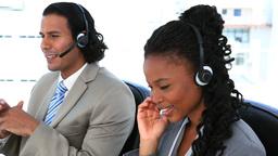People in suit speaking through headset Footage