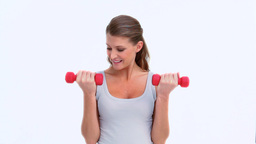 Beautiful woman using dumbbells Stock Video Footage