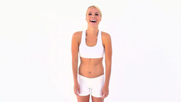 Blonde shrugging her shoulders after touching her Stock Video Footage