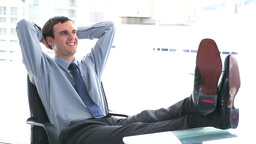 Businessman at ease the feet on his desk Stock Video Footage
