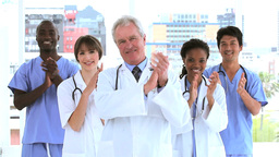Medical team clapping their hands Footage