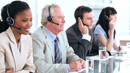 Cheerful business team using headsets Stock Video Footage