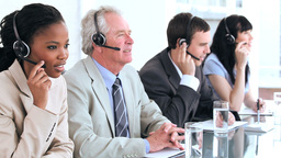 Cheerful business team using headsets Footage