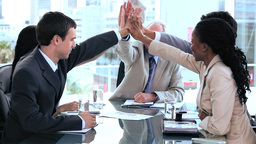 Happy business team giving highfive Stock Video Footage