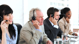 Happy business team using headsets Stock Video Footage