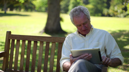 Retired man using an ebook Stock Video Footage