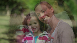 Little girl holding a flower with her mother Stock Video Footage
