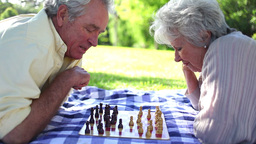 Two retired people playing chess Footage