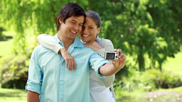 Happy couple taking themselves in picture Footage