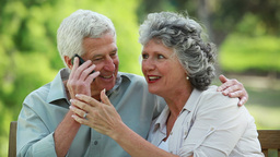 Mature couple using a cellphone together Stock Video Footage