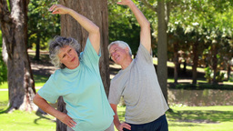 Happy couple doing fitness exercises Stock Video Footage