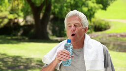 Smiling mature man drinking water Stock Video Footage