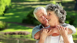 Smiling mature man embracing his wife Footage