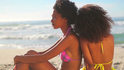 Peaceful women sitting on the beach Stock Video Footage