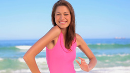 Happy woman placing her hands on her hips on the b Stock Video Footage