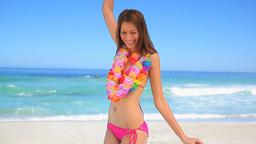 Happy brunette woman wearing a hawaiian necklace Footage