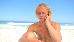 Serious blonde man using his mobile phone Footage