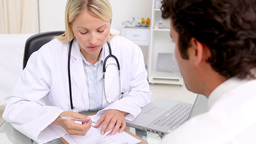 Doctor giving a prescription to her patient Stock Video Footage