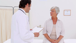Smiling patient talking with her practitioner Footage
