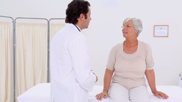 Serious doctor examining a mature woman Stock Video Footage
