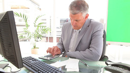 Businessman calculating bills Stock Video Footage