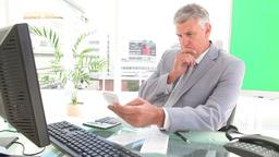 Businessman calculating bills Stock Video Footage