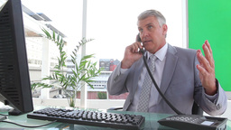 Furious businessman ending a call Stock Video Footage