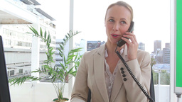 Businesswoman happy as she talks on the phone Footage