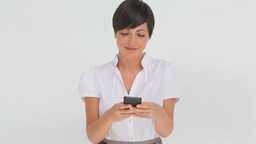 Businesswoman typing a text message Footage
