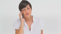 Businesswoman concentrating as she talks on a phon Footage