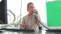 Angry businesswoman ending a call Footage