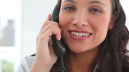 Happy businesswoman answering the phone Stock Video Footage