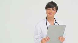 Doctor holding a clipboard Stock Video Footage