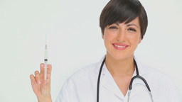 Doctor holding a syringe Stock Video Footage
