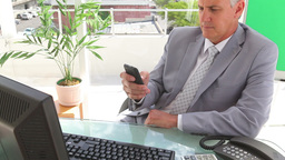 Businessman writing a text message Stock Video Footage