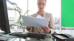 Businesswoman reading documents Footage