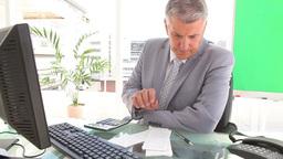 Serious businessman calculating bills Footage