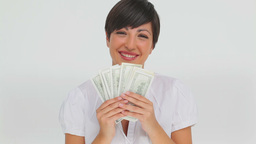 Businesswoman holding a fan of bank notes Footage