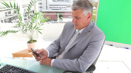 Businessman writing a text message Footage