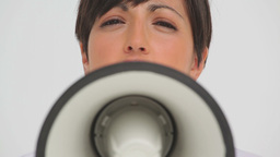 Businesswoman speaking through a megaphone Stock Video Footage